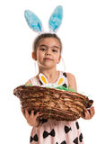 Girl with bunny ears holding basket Stock Photo