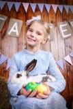 Girl with bunny stock photo