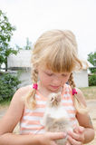 Girl and bunny pet Stock Images