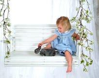 Girl and Bunny on Swing stock photo