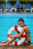 Girl with buoy Stock Images