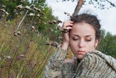 Girl with burdock Stock Photography