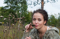Girl with burdock Royalty Free Stock Photography