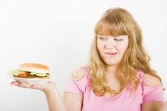 Girl and a burger Stock Image
