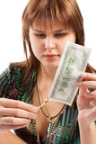 Girl burning a banknote Royalty Free Stock Photography