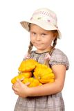 Girl with bush pumpkins. Stock Photos