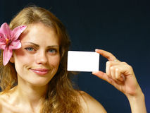 Girl with a business card. Beautiful young Ukrainian girl with a flower Stock Photography