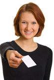 Girl with a business card. Shallow DOF. Focus is on the card Stock Images