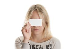 Girl with the business card. In her hand covering her eyes isolated in white Stock Photo