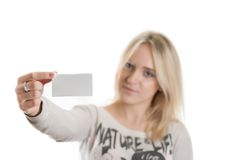 Girl with the business card. In her hand isolated in white Stock Photos