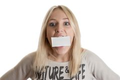 Girl with the business card. In her mouth  isolated in white Stock Image