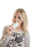 Girl with the business card. Smiling girl with the business card in her hands isolated in white Royalty Free Stock Image