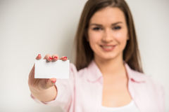 Girl with a business card Royalty Free Stock Photography