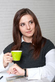 Girl in business clothes drinking coffee Royalty Free Stock Photo