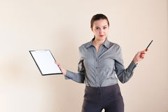 Girl in business style with a folder Stock Photos
