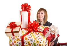 Girl in business suit with group of gift box. Stock Photos