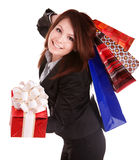 Girl in business suit with group gift box and bag. Royalty Free Stock Photo