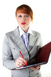 Girl in a business suit holds a folder Royalty Free Stock Image