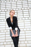 Girl in  business suit and with the laptop Royalty Free Stock Image