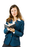 Girl in a business suit with a notebook Royalty Free Stock Image