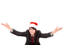 Girl in business suit, santa hat with arms raised. Royalty Free Stock Image