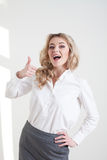 Girl in a business suit shows characters hands Royalty Free Stock Image