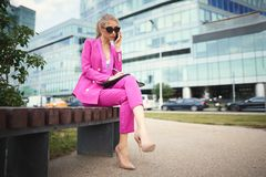 Young beautiful business woman talking on the phone. Business concept royalty free stock photography