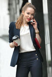 Girl in a business suit talking on the phone Royalty Free Stock Image
