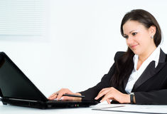 Girl in a business suit working Royalty Free Stock Image
