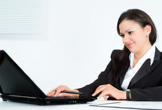 Girl in a business suit working Royalty Free Stock Photos