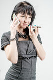 Girl businessman talking on cell phone Stock Images