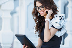 Girl businessman working with tablet PCs . Royalty Free Stock Photography