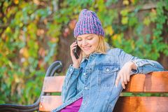 Girl busy with smartphone green nature background. Woman having mobile conversation. Girl smartphone call friend. Stay. Touch with modern smartphone. Mobile stock image