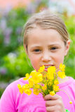Girl with buttercups in summer Stock Photos