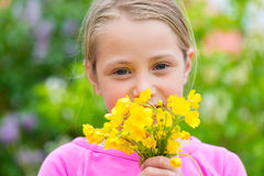 Girl with buttercups in summer Royalty Free Stock Photos