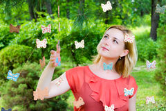 Girl with Butterflies. Portrait of a beautiful girl in a fairytale garden stock image