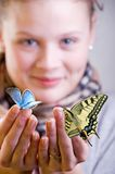 Girl with butterflies Stock Image