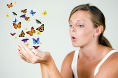 Girl with butterflies royalty free stock image