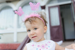 Girl with Butterflies on Headband Stock Images