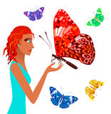 Girl and butterflies. Girl holding a huge butterfly Royalty Free Stock Photos