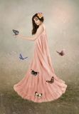 Girl and butterflies Royalty Free Stock Images