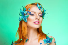 Girl with butterflies Stock Photos