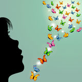Girl and butterflies in the sky Royalty Free Stock Photography
