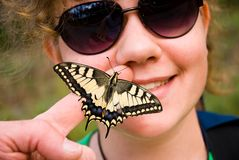 Girl with butterfly Stock Photography