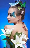 Girl with butterfly bodyart Royalty Free Stock Image