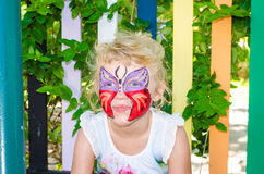 Girl with butterfly face painting stock photo