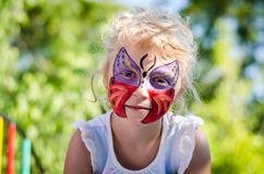 Girl with butterfly face painting stock images