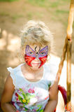 Girl with butterfly face painting stock photography