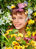 Girl with butterfly and  flower. Stock Photo
