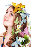 Girl with butterfly and flower on head. Royalty Free Stock Photos